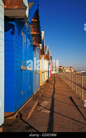 A row of beach huts along the east promenade at Cromer, Norfolk, England, United Kingdom. - Stock Photo