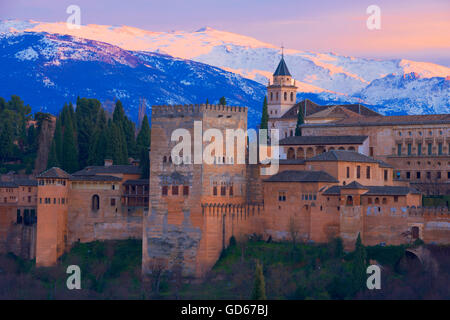 Alhambra, UNESCO World Heritage Site, Sierra Nevada and la Alhambra at Sunset, Granada, Andalusia, Spain - Stock Photo