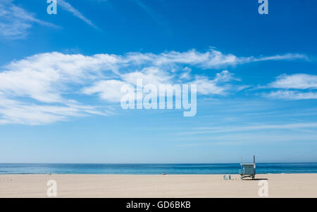 A scenic of a Malibu, CA beach with a lifeguard tower. - Stock Photo