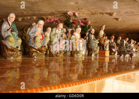 Ceramic Wisemen at the Cave Temple in Ipoh, Malaysia - Stock Photo