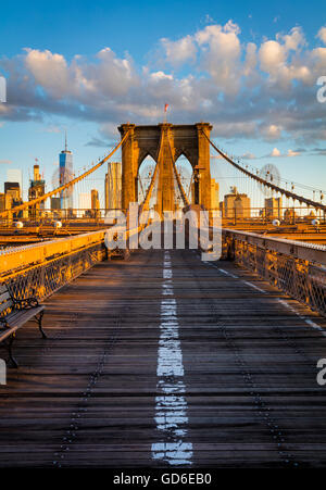The Brooklyn Bridge in New York City is one of the oldest suspension bridges in the United States - Stock Photo