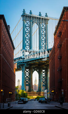 The Manhattan Bridge is a suspension bridge that crosses the East River in New York City. - Stock Photo
