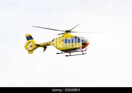 BATH, UK - JULY 11 2016 Western Power Distribution Helicopter. Electricity service aircraft in flight inspecting - Stock Photo