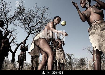 The Ncoakhoe San bushmen perform a ritual dance around a fire at D'kar near Ghanzi in Botswana - Stock Photo