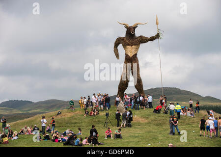 Dundrennan Scotland, UK - July 26, 2013: Festival goers at the Wickerman Festival at the Wickerman that is created - Stock Photo