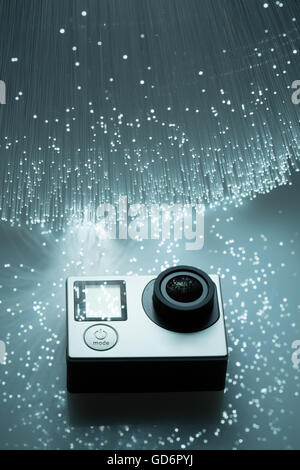 Action camera and Fiber optics background - Stock Photo