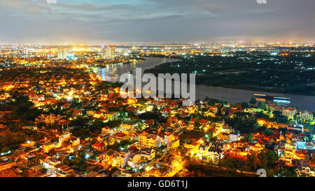 Impression landscape of Ho Chi Minh city from high view, Vietnam at night, city in vibrant, colorful light, houses - Stock Photo