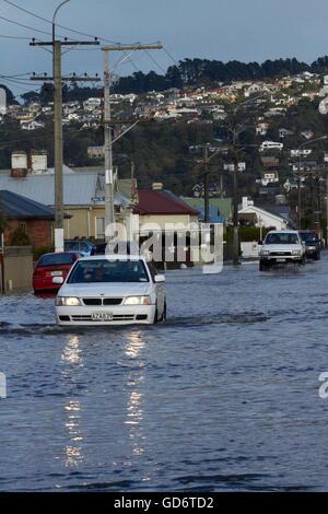 Traffic on flooded Bay View Road, South Dunedin floods, Dunedin, South Island, New Zealand - Stock Photo
