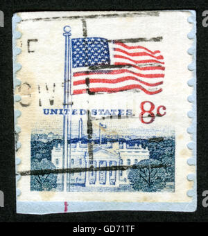 UNITED STATES OF AMERICA - CIRCA 1968: A used postage stamp printed in United States shows a waving USA flag on - Stock Photo
