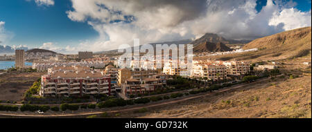 Panorama over the holiday resort of Los Cristianos, Tenerife, with the iconic mountain of Roque del Conde in the - Stock Photo