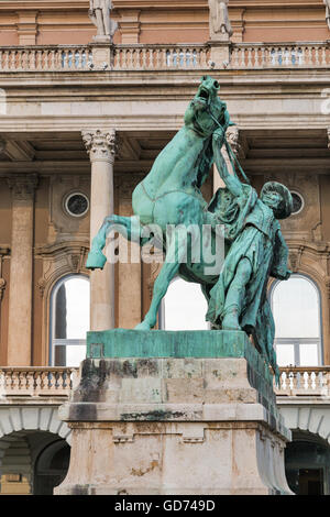 Statue of the Csikos, Hungarian horse wrangler, in the court of Buda castle in Budapest Hungary. Statue Lofekezo - Stock Photo