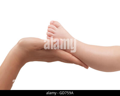 Mother holding her three month old baby son's foot in her hands - Stock Photo