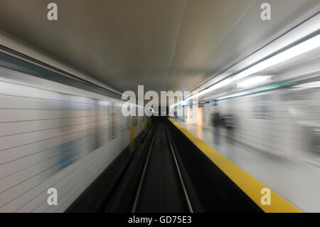 Subway platform in a dynamic motion blur from departing train, Toronto, Ontario, Canada - Stock Photo