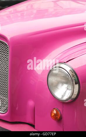 Pink Car Headlight in daylight - Stock Photo