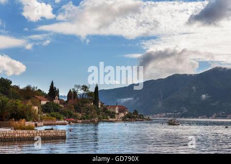 Ljuta waterfront, and Prčanj across the Bay of Kotor (Boka Kotorska), Montenegro - Stock Photo