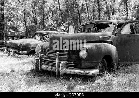 Crawfordville, Florida - USA. May 2016 - Old trucks and cars abandoned and rusting on the side of the road near Crawfordville