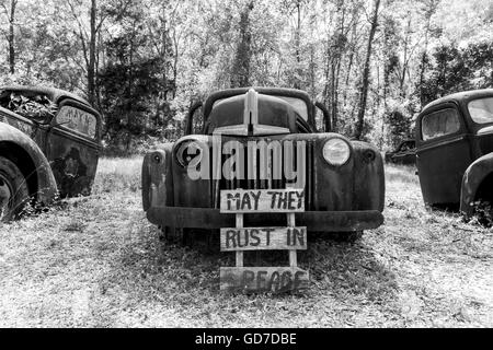Crawfordville, Florida - USA. May 2016 - Old rusted trucks and cars abandoned on the side of the highway - Stock Photo