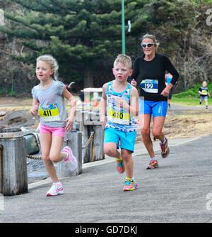 Children taking part in a local run race, Kiama, Illawarra Coast, New South Wales, Australia - Stock Photo