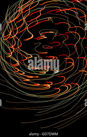 Colorful patterns of light created by painting with light during a fireworks show - Stock Photo