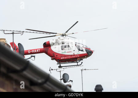 The Essex and Hert air ambulance taking off after attempting an incident - Stock Photo
