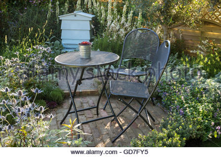 ... Small Summer Cottage Style Garden With Brick Patio, Metal Table And  Chairs, And Silver