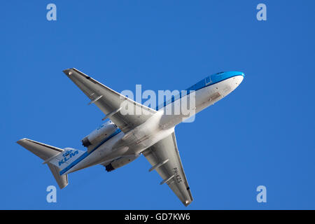 AMSTERDAM, THE NETHERLANDS - FEBRUARY 18, 2015 Just ascended boeing from the  klm at Schiphol airport, lightened - Stock Photo
