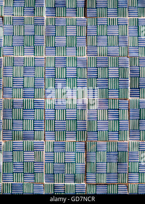 Plaid patterned tiles in blue, green and white - Stock Photo
