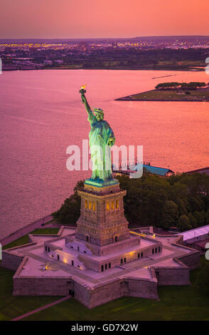The Statue of Liberty is a colossal neoclassical sculpture on Liberty Island in New York Harbor in New York City - Stock Photo
