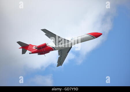 At the Farnborough International Airshow 2016 T2 Aviation's Boeing 727-2S2F demonstrated how the company combats - Stock Photo
