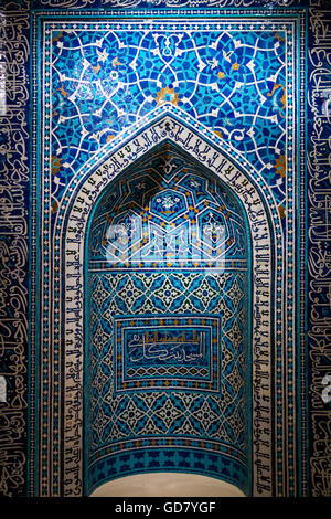 A 14th-century prayer niche, or mihrab, from a theological school in Isfahan, Iran. - Stock Photo
