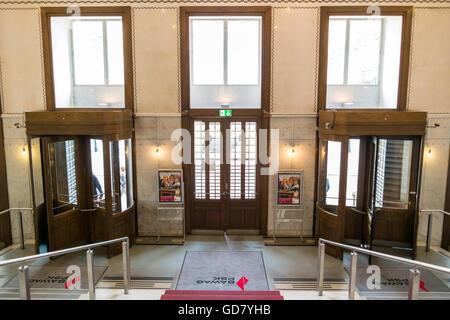 Revolving doors of entrance hall of Austrian Post Office Savings Bank in Vienna, Austria - Stock Photo