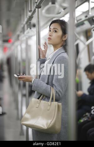 Young women take the subway - Stock Photo