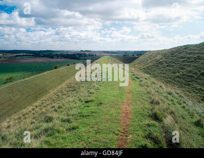 Looking eastwards along the ramparts on the north side of Maiden Castle Iron Age hill fort. Dorchester, Dorset, - Stock Photo