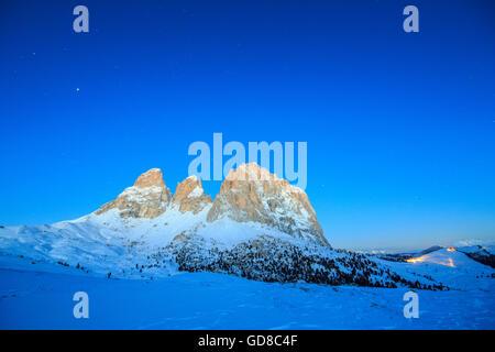 The blue dusk on Sassopiatto and Sassolungo Dolomites Fassa Valley Sella Pass Trentino Alto Adige Italy Europe - Stock Photo