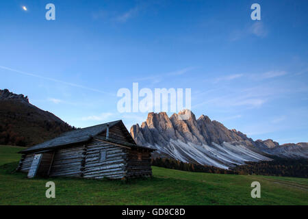 The early morning light illuminates Zannes Alm and the Odle in background Funes Valley South Tyrol Dolomites Italy - Stock Photo