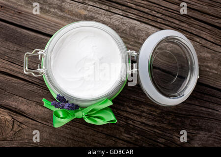 Handmade DIY natural body butter with lavender and coconut oil, almond oil and shea butter - Stock Photo