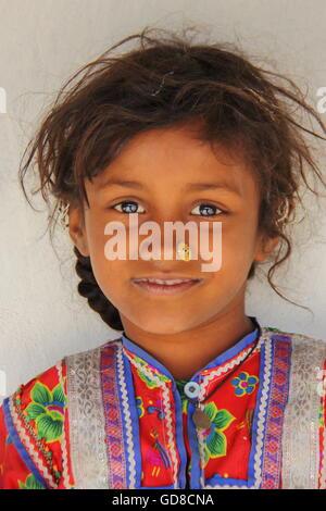 Portrait of a cute and colourful little girl in Hodka, local village near Bhuj, Gujarat, India - Stock Photo