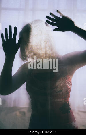 Trapped woman in distress - Stock Photo