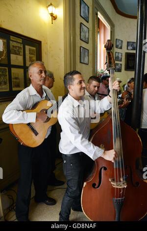 Cuban musicians playing at the Floridita cocktail bar in old Havana, Cuba. - Stock Photo