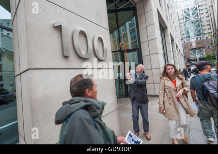 London, UK. 13th July, 2016. Ian Bone of Class War holds up his walking stick at the sign on the 100 Wood St offices - Stock Photo