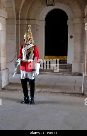 A dismounted guard of The Life Guards stands guard at the Horse Guards Parade London - Stock Photo