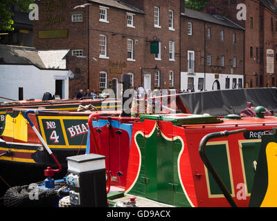 Narrowboats on the Birmingham Canal and Canalside Pub at Gas Street Basin Birmingham West Midlands England - Stock Photo