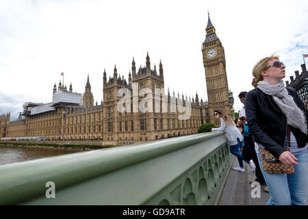 The Houses of Parliament a London landmark from Westminster Bridge with a view of the river - Stock Photo