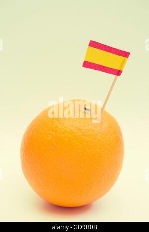Spanish flag stuck in an orange - Stock Photo