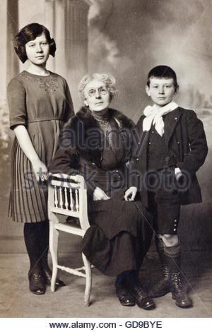 studio portrait of grandmother with children 1900s - Stock Photo
