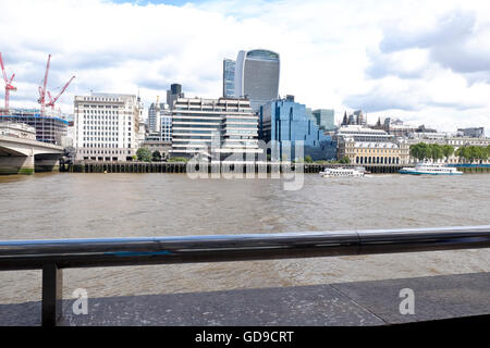 The London skyline viewed over the Thames river 20 Fenchurch Street 'The Walkie Talkie'  a London landmark prominent - Stock Photo