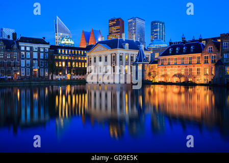 Skyline of The Hague with the modern office buildings behind the historic Mauritshuis museum at Blue Hour in the - Stock Photo