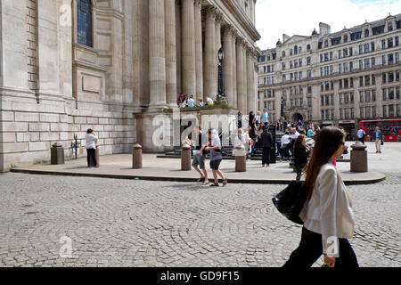 Tourist outside St Paul's Cathedral a London landmark - Stock Photo