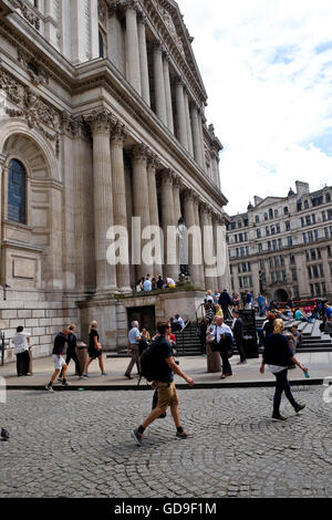 Tourists outside St Paul's Cathedral a London landmark - Stock Photo