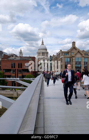 London, United Kingdom. London Skyline from the Millennium Bridge which crosses the Thames river with St Paul's - Stock Photo